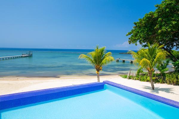 PRIVATE BEACH - HUGE INFINITY POOL - STUNNING REEF - Image 1 - Antoneys Cay - rentals