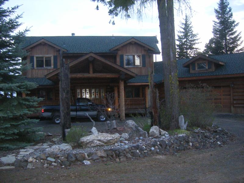 front of house shown with 3/4 ton Dodge Ram for size comparison - Mountain Ridge Log Home - Mead - rentals