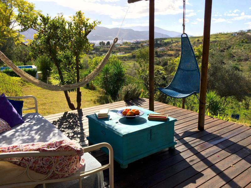 Comfortable shaded deck area with spectacular views across the valley - Finca Shambala - Malaga - rentals