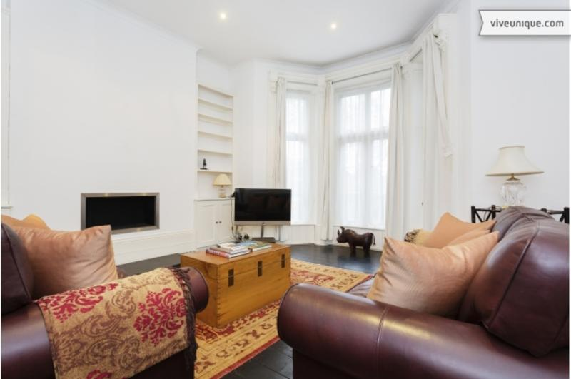 A lovely four-bedroom flat in popular Kentish Town. - Image 1 - London - rentals