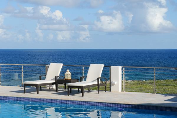 Panoramic Caribbean Sea views are enhanced in this villa where luxury and old world elegance meet. IDP MOO - Image 1 - Sile Bay - rentals
