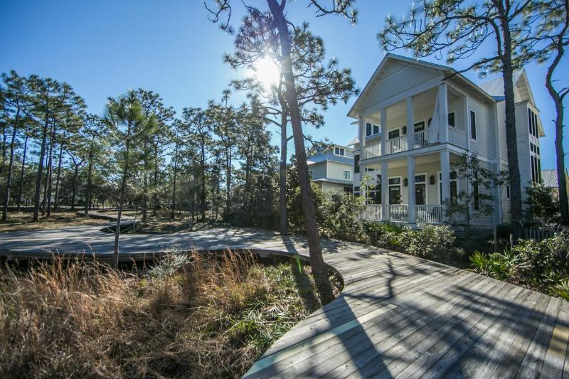 Back of the house along with pathway through the woods - 100 FLATWOOD STREET - Santa Rosa Beach - rentals