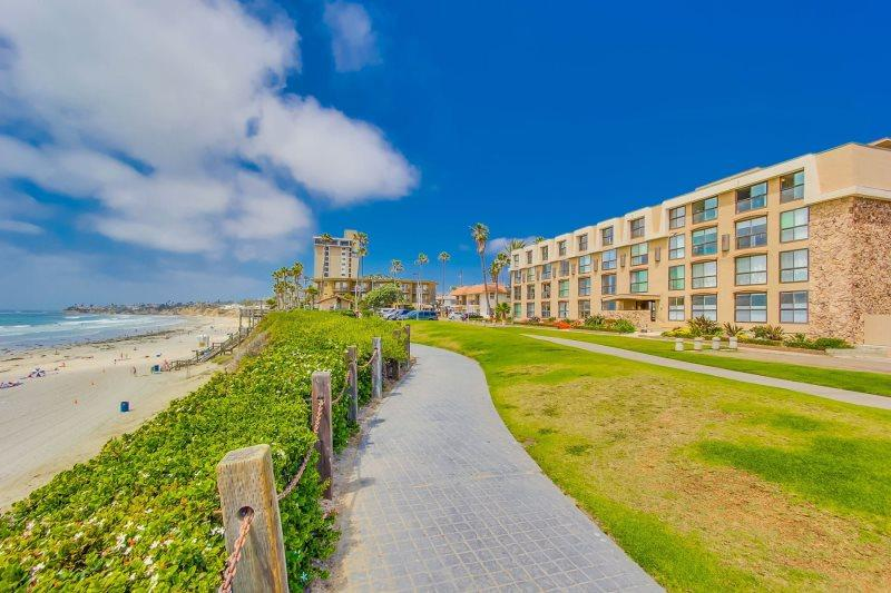 Beautiful beach front condo building - Bree's Ocean Point Penthouse: Panoramic Ocean and Sunset Views, Steps from Boardwalk and Sand, Bikes - Pacific Beach - rentals