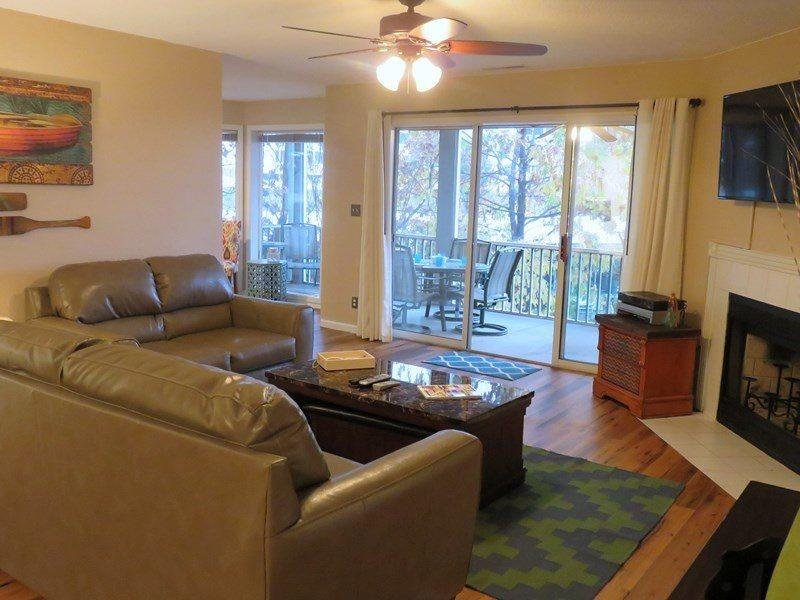 Nice sized living room with leather seating queen sofa sleeper fireplace candles only, flat screen TV  and overlooks the screened in porch and lake front - Regatta Bay 432-1A - Another Great Corner Unit Condo in Regatta Bay Complex. 12 MM Osage Main Channel - Lake Ozark - rentals