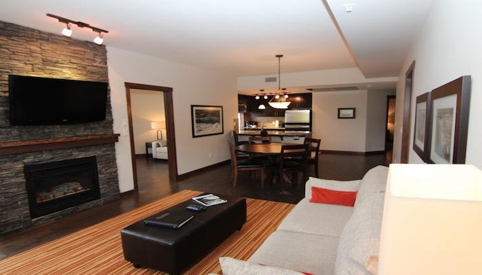 Beautiful hardwood floors and an exquisite, rock fireplace make this condo feel elegant and inviting. - Stunning Canmore Condo - 2 bedroom 2 bathroom plus Den (sleeps 7) - Canmore - rentals