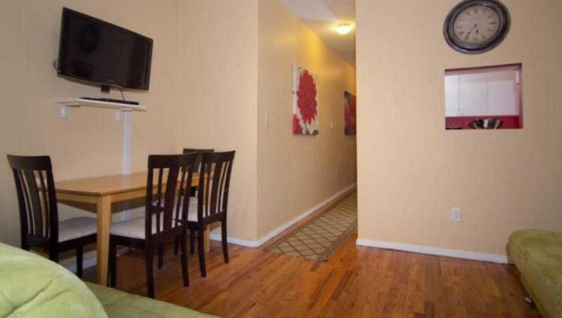 Contemporary 3 Bedroom, 2 Bathroom Apartment in Midtown West - Steps Away From Time Square - Image 1 - New York City - rentals