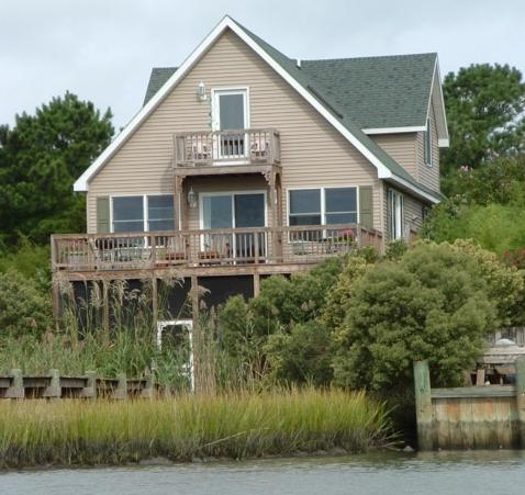 House view from water and our dock on the left. - Eagle's View - Chincoteague Island - rentals