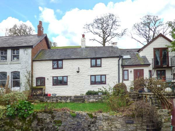 ISFRYN, character, semi-detached cottage, woodburning stove, pet-friendly - Image 1 - Llanferres - rentals