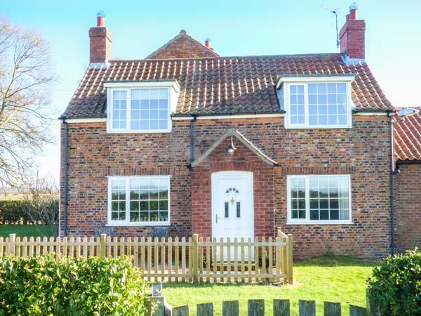 LILAC FARM COTTAGE, red brick cottage, enclosed patio, pet-friendly, open views, adjacent to owner's horse racing yard, Thornton-le-Dale, Ref 933166 - Image 1 - Thornton-le-dale - rentals