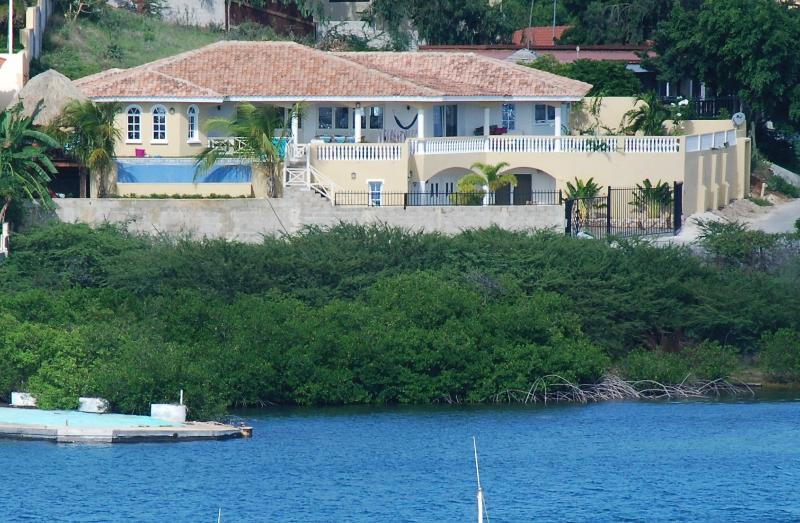 Villa Serenity as seen from the water - Waterfront Villa with Pool,Hot Tub,Gym&Ocean View - Willemstad - rentals