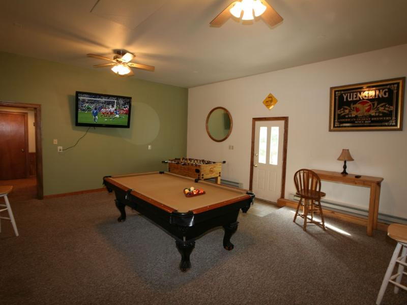 "Game room with 55"" flat screen tv and pool table that has been upgraded. See next photo.  - Has it All, Hot Tub, Pool Tbl/Air Hockey, Lrg Flt Scr Tvs - Lake Harmony - rentals"