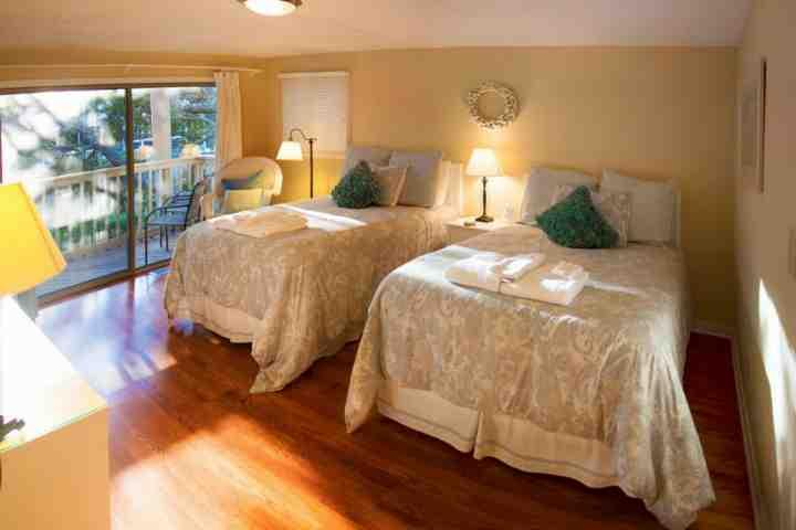 1st bedroom suite with 2 full beds and balcony - Spacious 2 BD/2 BA Lagoon Views in Wild Dunes-IOP - Isle of Palms - rentals