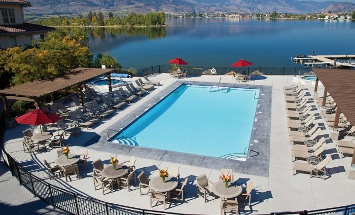 Laze in the sun by the outdoor pool, overlooking Osoyoos Lake - 2 Bedroom Premium Gamay Condo: Lake View | Walnut Beach Resort, Osoyoo - Osoyoos - rentals