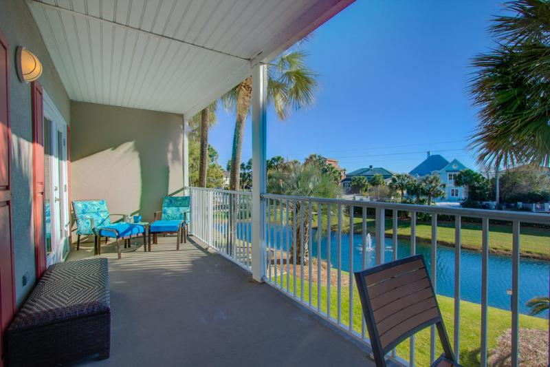 Relax on your personal balcony, with views of the courtyard and the Caribbean pool. - Brand new 2 bedroom condo in Gulf Place - Gulf Place Caribbean - Santa Rosa Beach - rentals