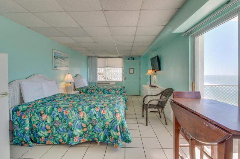 Ocean front condo w/ double balconies & shared pool. Close to all the fun! - Image 1 - Panama City Beach - rentals