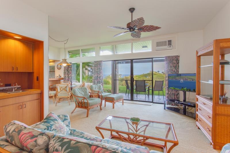 Spacious living/dining room with ocean view. large grass area off lanai adds feeling of extra space - Fabulous Ocean/Golf Views +Indoor/Outdoor Living - Lahaina - rentals