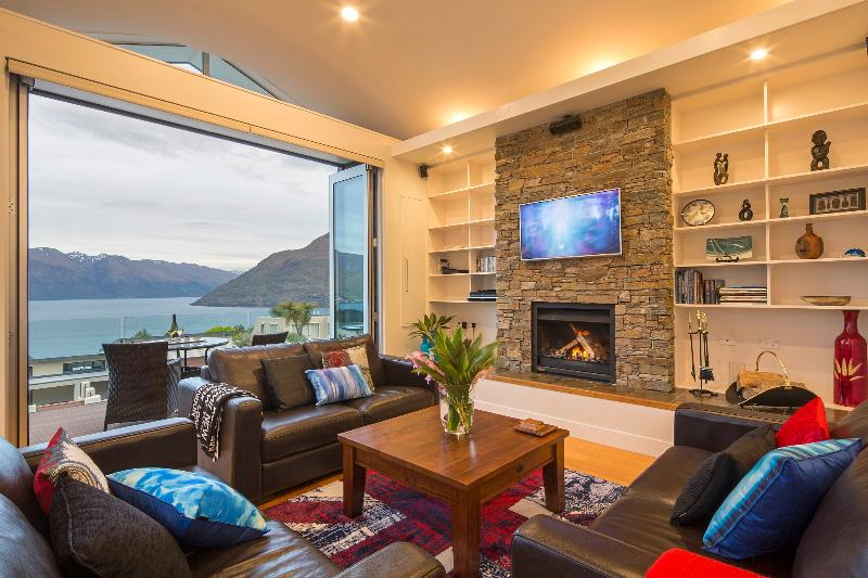 Bi-fold doors, lake views and log fireplace creating the perfect alpine environment - Mountain Vista, luxury Queenstown holiday home - Queenstown - rentals