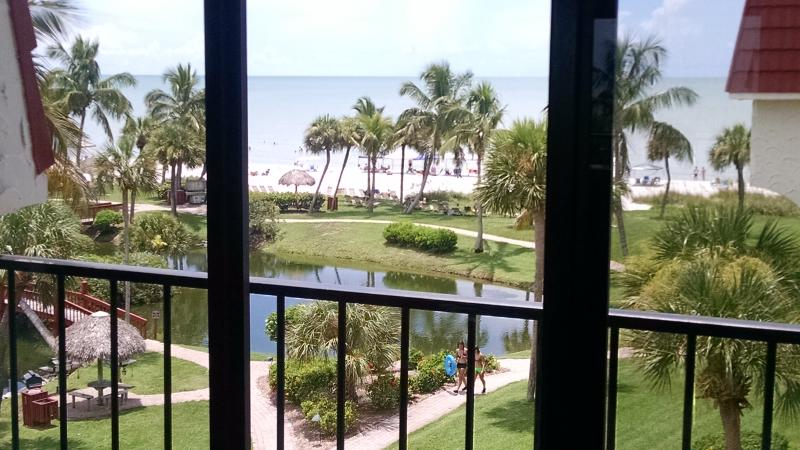 Breathtaking views of the Gulf, pool, & landscape right from your living room - Gulf Views Galore!  Pt Santo B47 penthouse, sundec - Sanibel Island - rentals