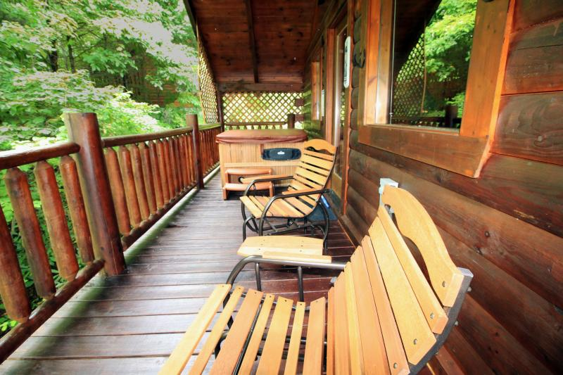 Relax on the gliding chairs while enjoying privacy on the upper deck. - Romantic and Private Getaway Anniversary or Honeymoon Cabin - Gatlinburg - rentals