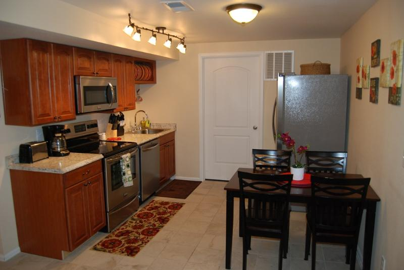 Kitchen with stainless steel appliances - The Cottonwood 2 bed 1 bath furnished rental - Colorado Springs - rentals