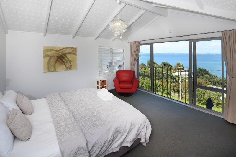 Bedroom with sea views and luxury linen - Designer Waiheke Island house - stunning sea views - Oneroa - rentals