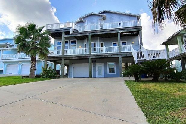 View of home from street.  Ample parking for up to 6 cars or boats. - 4 bedroom 3 bath 3 story home in Sand Point ! - Port Aransas - rentals