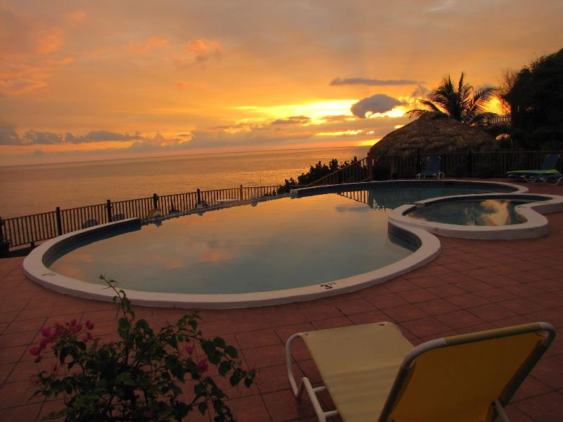 Spectacular sunsets overlooking the Jacuzzi, pool, and Caribbean Sea - Villa de l'Ocean located on the edge of the sea - Treasure Beach - rentals