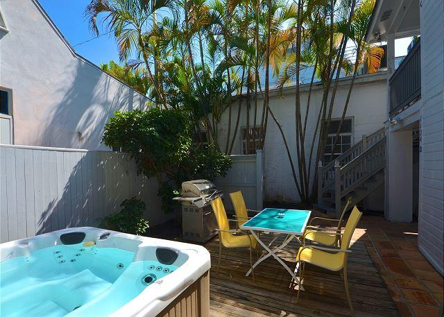 Brand new hot tub, outdoor eating area, and grill! Shared with your neighbor upstairs. - Southernmost Retreat- Spacious 2 BR Condo On Duval St! Private Parking! - Key West - rentals