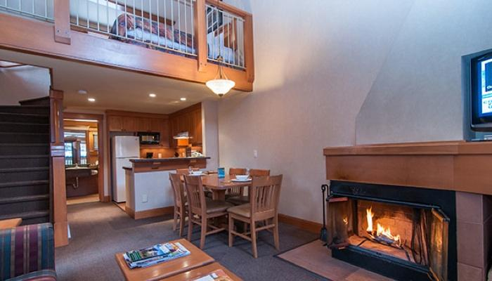 Relax with friends or family by the wood-burning fireplace in the spacious living area - Banff Hidden Ridge Resort 2 Bedroom + Loft Condo (4 Queens) - Banff - rentals