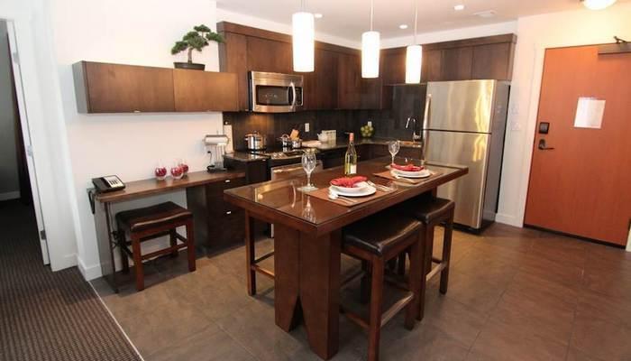 This condo's sleek kitchen boasts stainless steel appliances and maple cabinets. - Kimberley Mountain Spirit Lodge 2 Bedroom Luxury Condo - Kimberley - rentals