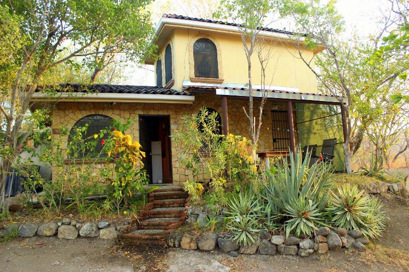 Cottage  , Bedroom is upstairs , shady patio to enjoy. - Romantic hillside cottage- great sunset ocean view - Playa Flamingo - rentals