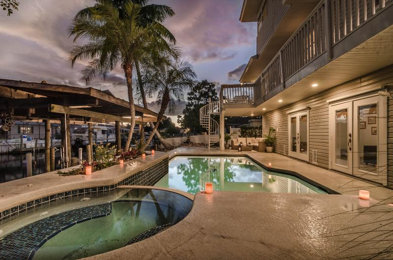 """Pool deck at sunset - """"Morning Coffee with a View"""": Pool, Spa, Dock & Plenty of Nautical Charm...mins. to Downtown Naples by car, bike or boat! - Naples - rentals"""