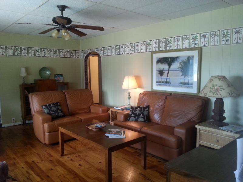 Living room with twin size recliners - Beach Cottage 50 Steps to Gulf of Mexico - Bradenton Beach - rentals