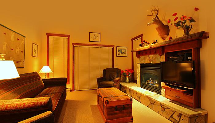 This living area features a cozy fireplace and a flat screen TV - Fernie Snow Creek Lodge 2 Bedroom Condo in Prime Location! - Fernie - rentals