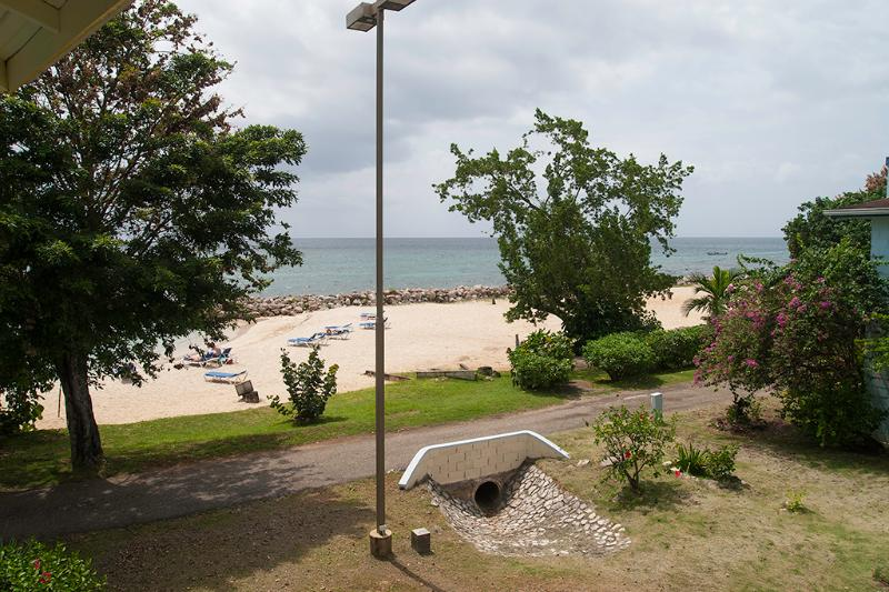 View from 2nd floor balcony to Point Village main beach - Point Village Beach View 2 BR/2BA Townhome - Negril - rentals