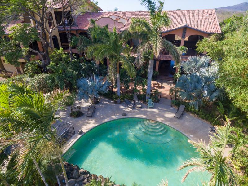 Lush pool and gardens for condo guests - New 2BR Playa Junquillal Condo at Tierra Pacifica - Playa Junquillal - rentals