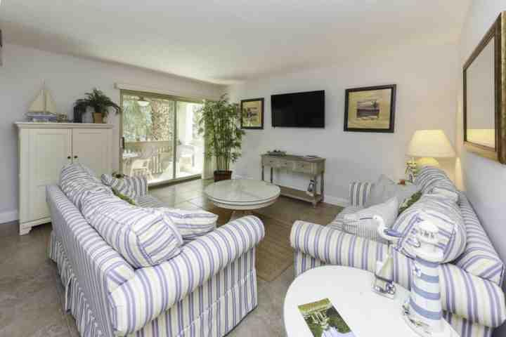Comfortable Family Room with Queen Sofa Sleeper - Fresh & Fun 2 BR / 2 BA  Bluffs Villa in South Beach - 2 minute walk to Salty Dog - Hilton Head - rentals