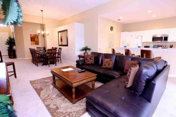 Open Floor Plan - Living Area, Dining Area & Kitchen w/Pool Access - 7741 Windsor Hills - Kissimmee - rentals