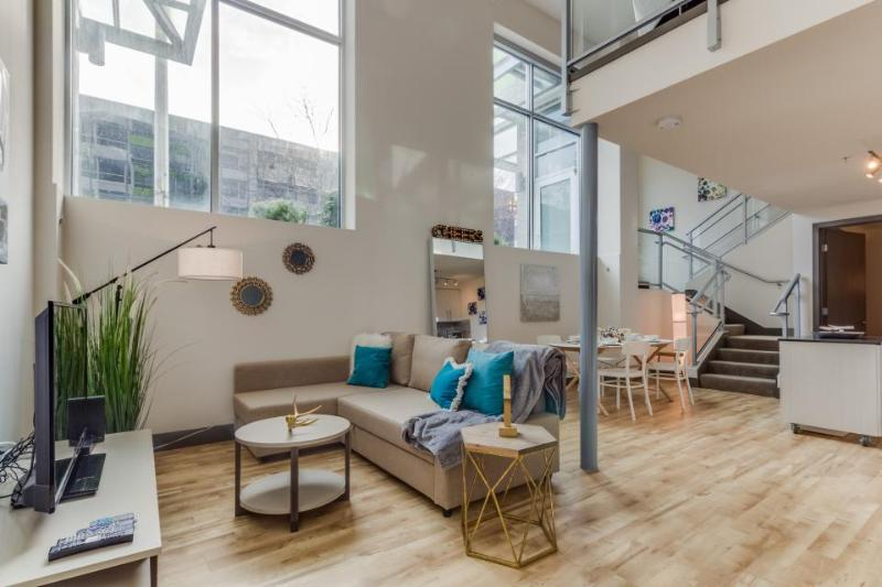 Dog-friendly designer condo with a loft, sky lounge & gym, near downtown! - Image 1 - Seattle - rentals