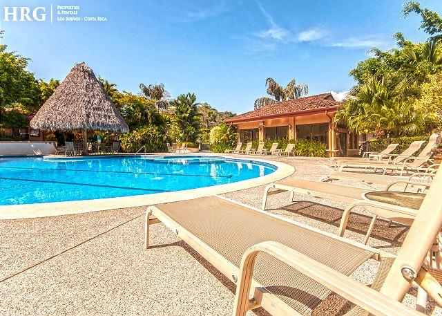 Pool Area, Sun Chairs, Shaded Palapas at Colina Community. - Family Friendly Luxury Condo Overlooking Golf Greens at Los Sueños! - Herradura - rentals