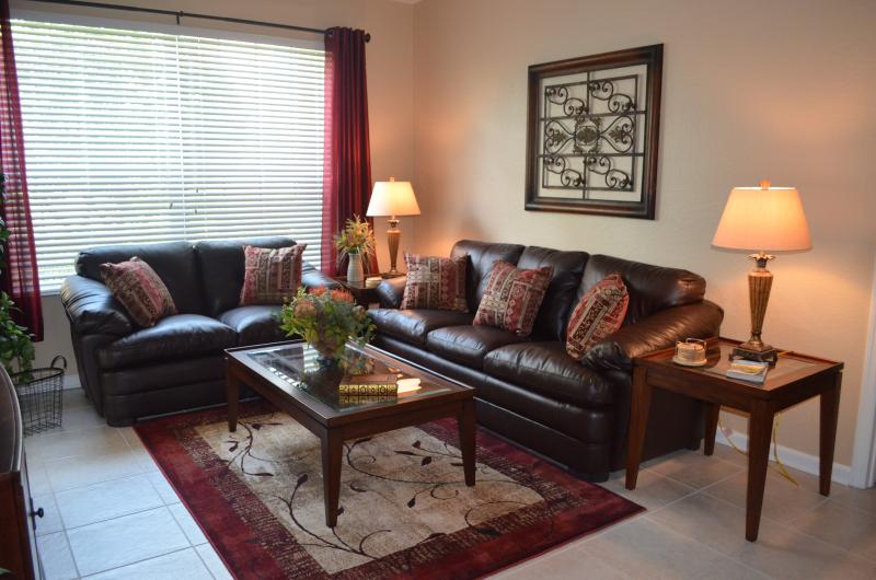 Living Room features comfortable leather furniture - Windsor Hills 3BR-2BA Condo - 2 Miles from Disney - Kissimmee - rentals