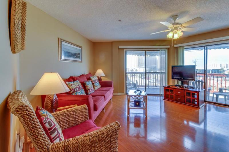 Relaxing retreat steps to the beach - includes shared tennis, pool, and sauna! - Image 1 - Panama City Beach - rentals