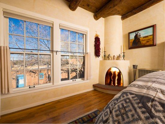 El Caminito bedroom with queen bed, on-suite bath, and working, kiva fireplace - El Caminito Flooded with Light, Magnificent - Santa Fe - rentals
