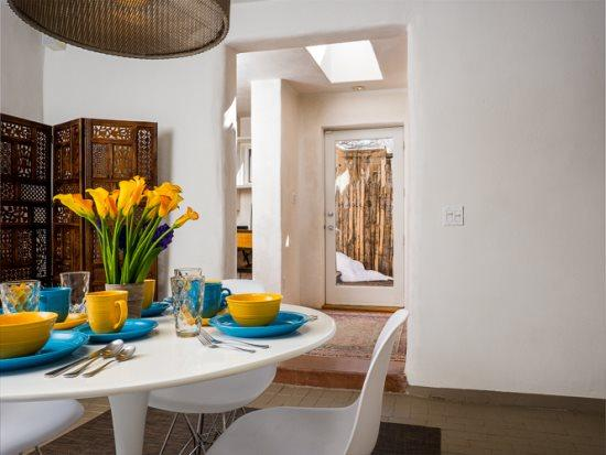 Dining area in Viejo Nuevo with seating for 4 and fireplace - Viejo Nuevo - An Old Adobe Home with a Contemporary Update. In the heart of the Rail Yard District - Santa Fe - rentals