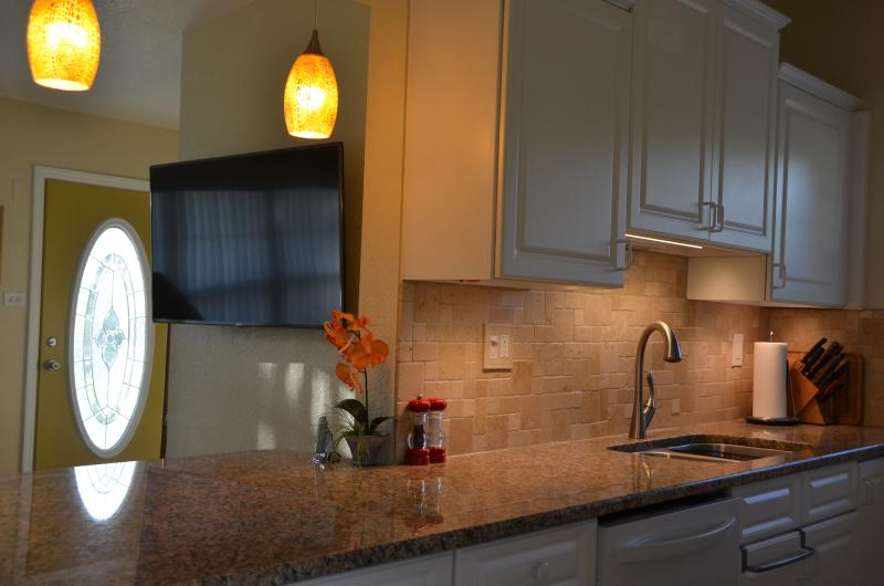 "Kitchen with 55"" wall-mounted TV in background - 160' Waterfront in Port Charlotte, Florida - Port Charlotte - rentals"