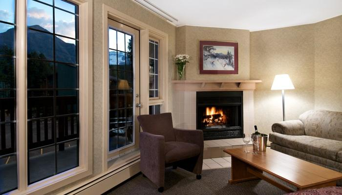 Snuggle up by the wood-burning fireplace - Studio 1 Queen | Lake Louise Inn, Lake Louise - Lake Louise - rentals