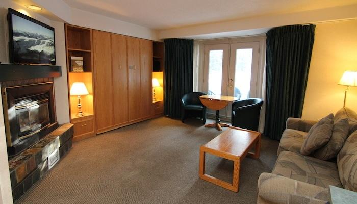 After an action-packed day in the Rockies, relax in this comfortable living area. - Lake Louise Inn 1 Bedroom Condo - Lake Louise - rentals