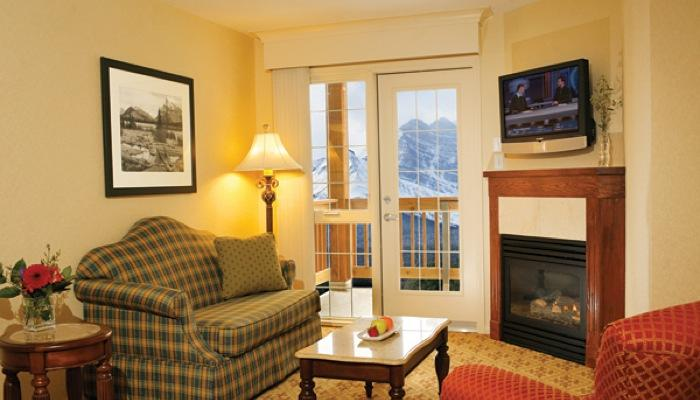 Reminisce about day while relaxing in the cozy living area - Deluxe 1 Bedroom Suite | Lake Louise Inn, Lake Louise - Lake Louise - rentals
