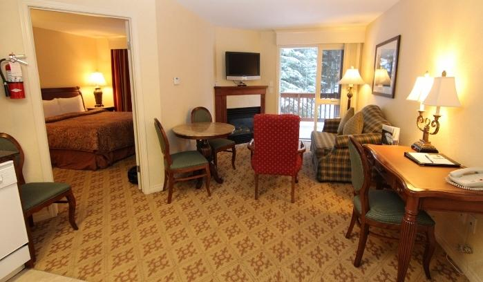 Lounge by the cozy fireplace - Deluxe 2 Bedroom Suite | Lake Louise Inn, Lake Louise - Lake Louise - rentals