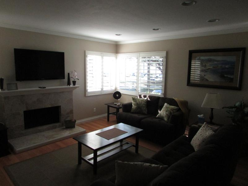 living room with view of ocean and ships off harbor - Attractive Ocean View Condo, Close to Beach, Pool - Dana Point - rentals